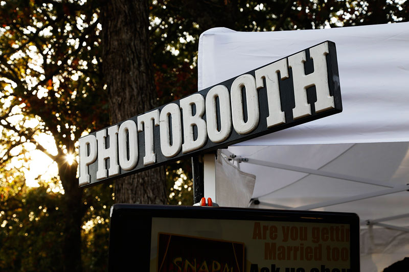 ipad station and hashtag printing outside photo booth in okc