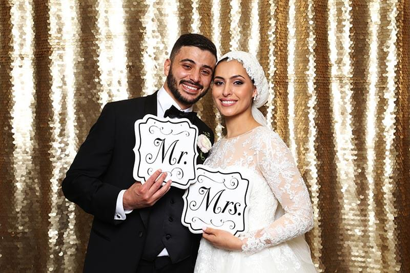 wedding photo booth couple take an amazing photo picture inside our snap me crazy photo booth