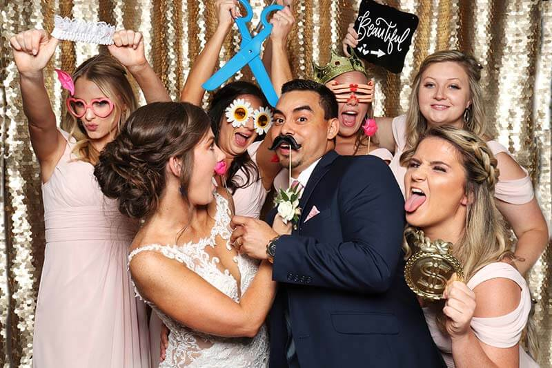 wedding brides strike a pose in a snap me crazy photo booth in oklahoma city,  Book your wedding today.